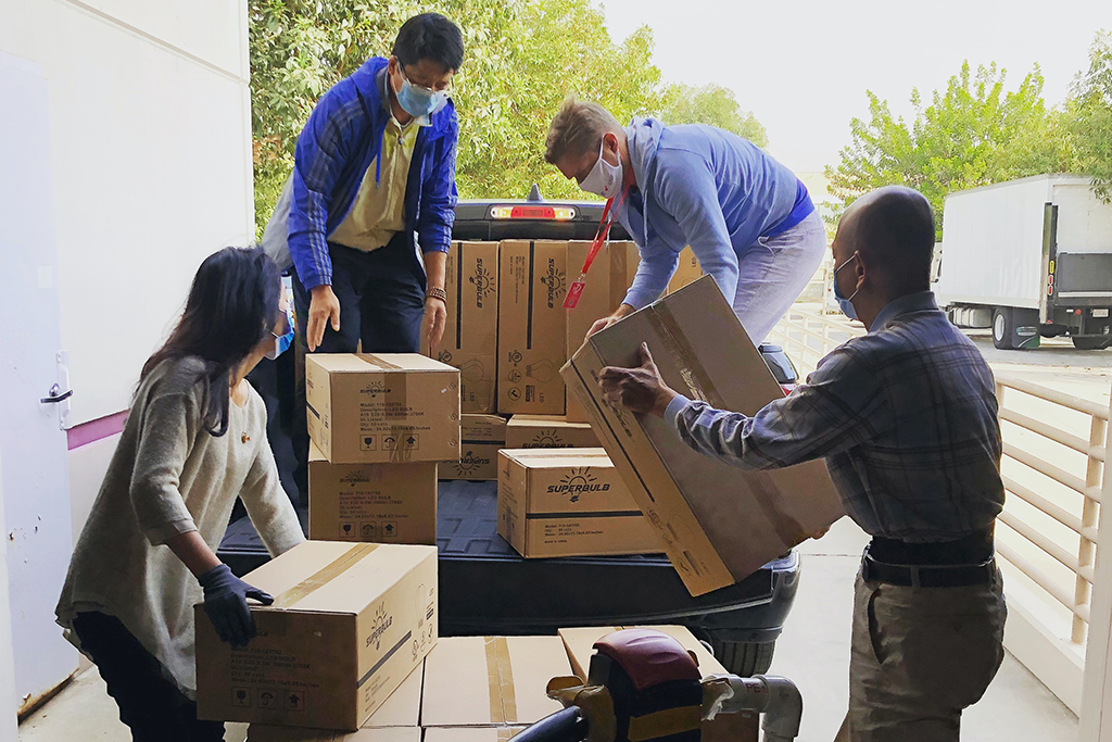 People moving boxes and streamlining their move.