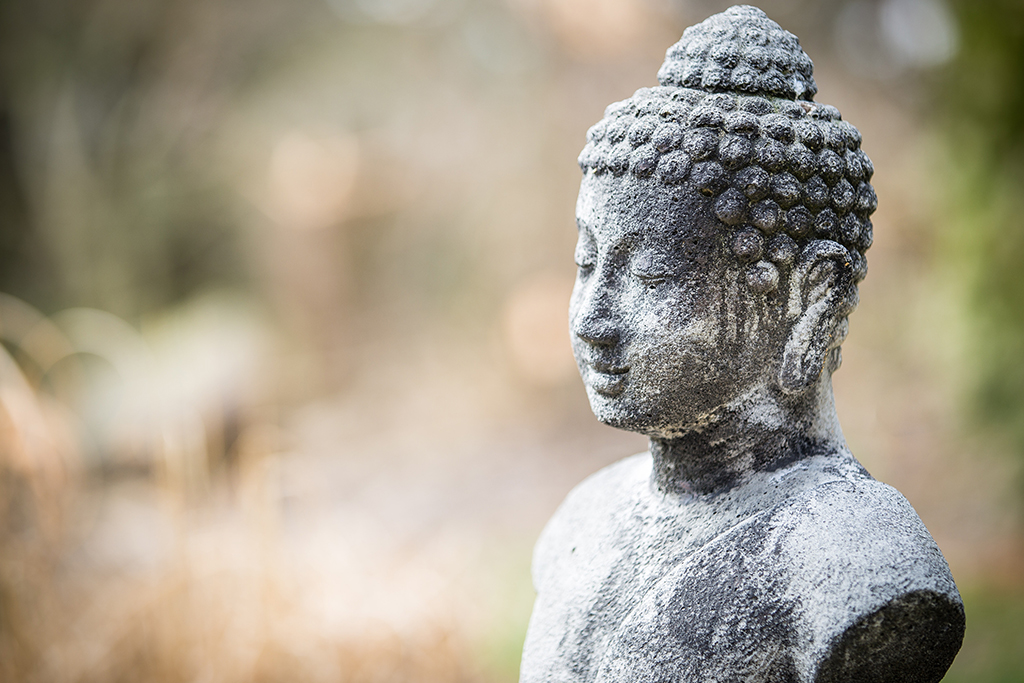 Cluttered space, cluttered mind. Buddha statue.