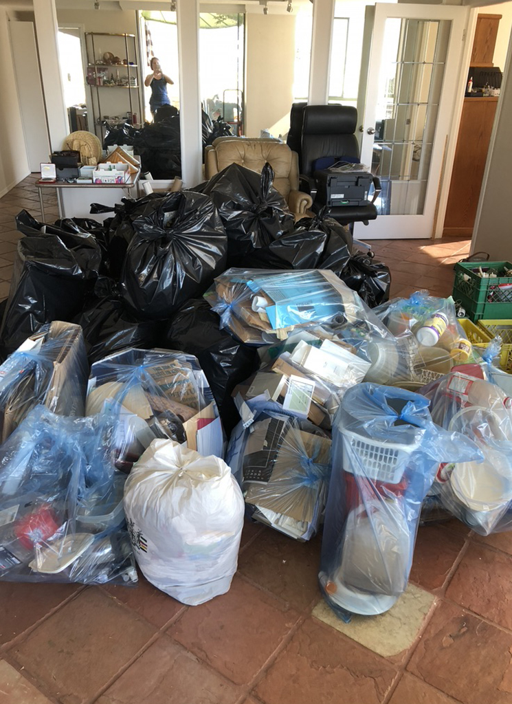Garbage and recyling pile after a downsizing.
